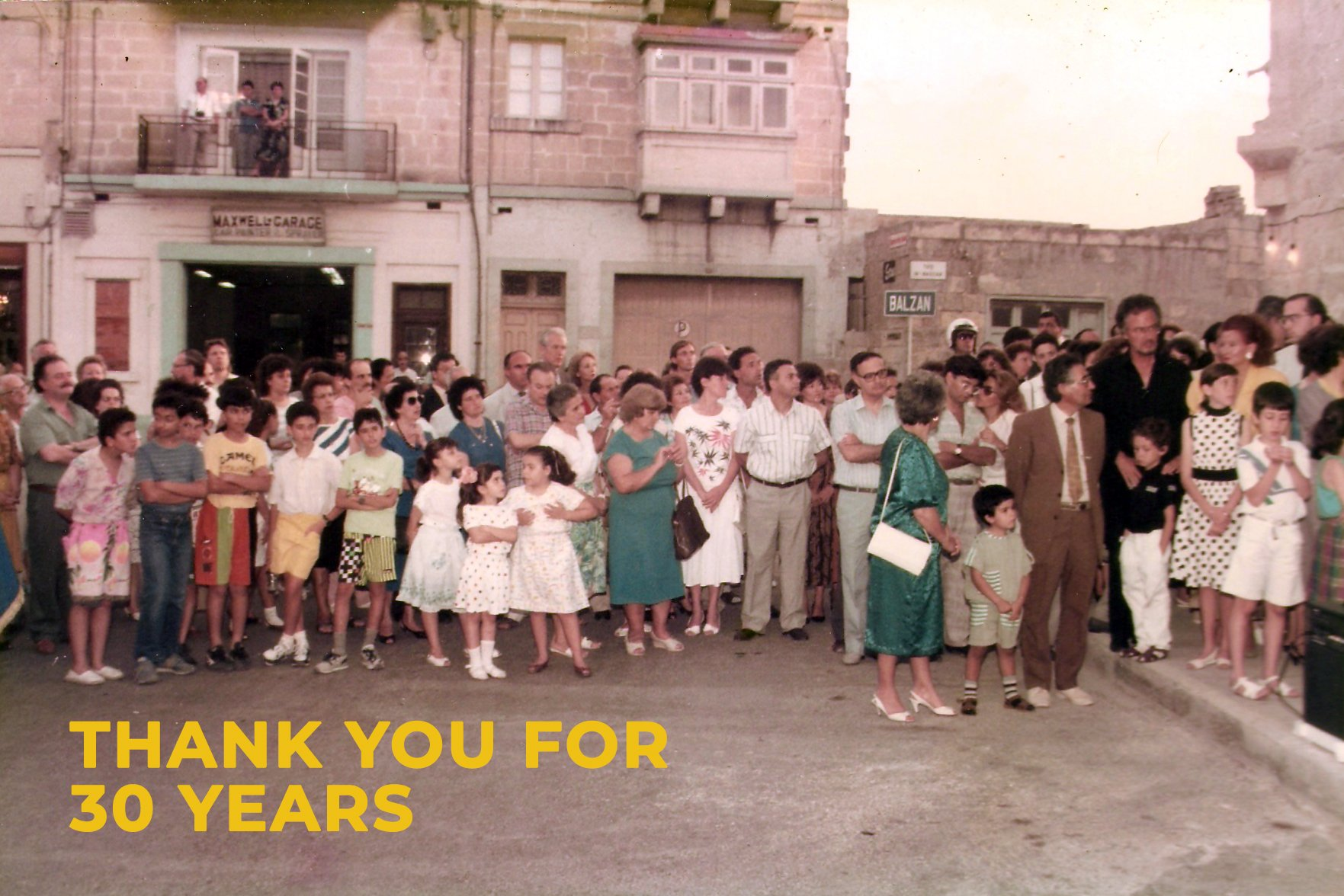 People gathered at The Mill opening on the 22nd of June 1990. At the bottom left hand corner text in yellow 'Thank you for 30 Years'.